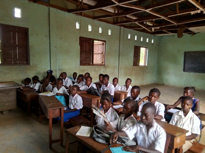 Children in one of the classrooms under delapedated ceilings, R C St Theresa Mano Dasse. (2)