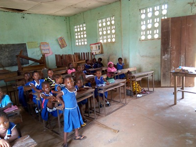 Class 1 pupils in the UMC primary school, Mano Dasse most of the benches and desks packed at the back are not in good order. So cannot be used