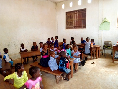 pre- school children in St Theresa in class ready for class